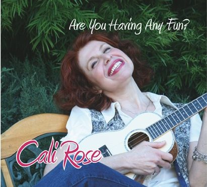 front cover of album features Cali playing ukulele while sitting on a bench and smiling