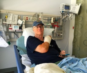 Recovery Room after Craig's surgery.  Cell phone attached to hand.