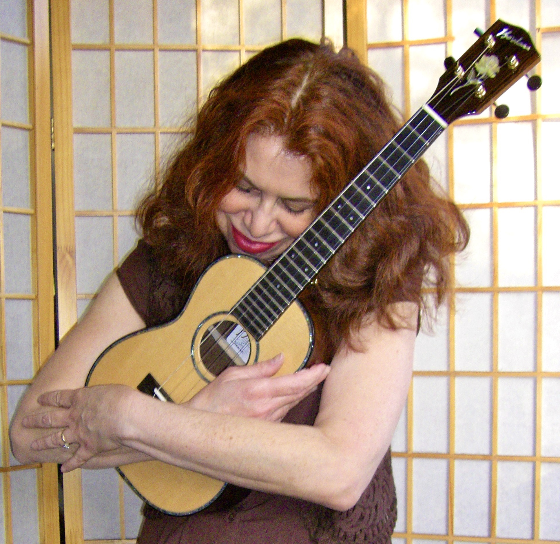 a woman hugging a ukulele